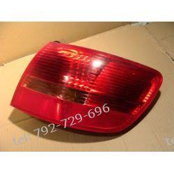 Audi A6 prawa tył kombi, kompletna z żarówkami i wkładem Lampy tylne