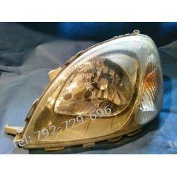 Toyota Yaris I lewa lampa przód + silniczek, oryginalna VALEO