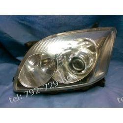 Toyota corolla prawa lampa przód oryginał, reperowany uchwyt + żarówka +silniczek + uszczelka