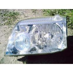 Reflektor lewy Nissan X-trail 2001-2006