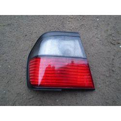 Lampa tylna zewnętrzna lewa Nissan Primera 1991-1996...